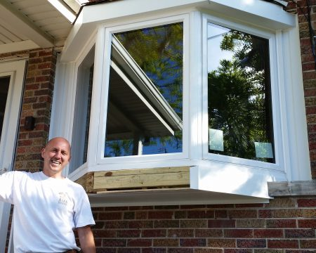 happy contractor suring window replacement in Chicago