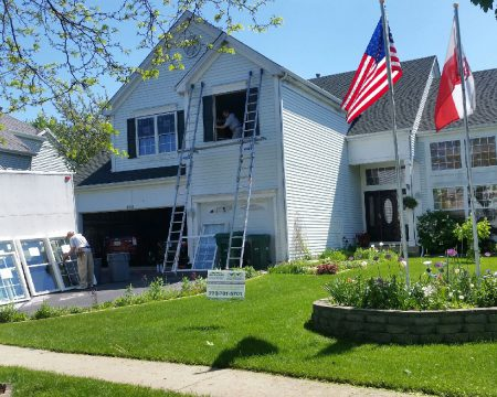 contractors during window replacement in big house in Chicago suburs