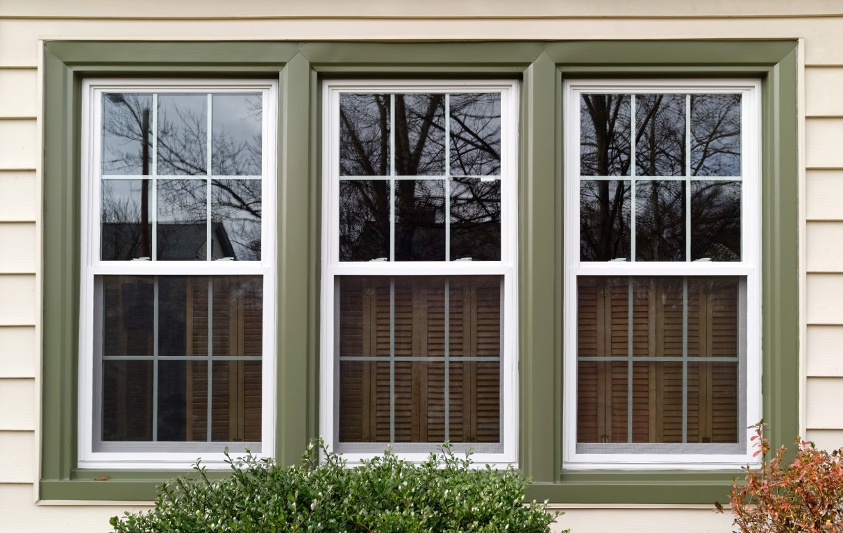 casement windows with green frame